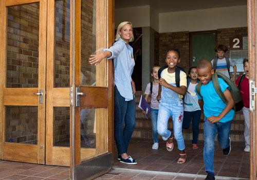 Children leaving school - running out the main door